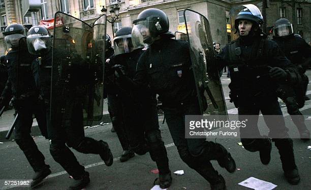 Riot police officers charge protesters at the end of a rally against the youth employment contract known as CPE April 4 2006 in Paris France...
