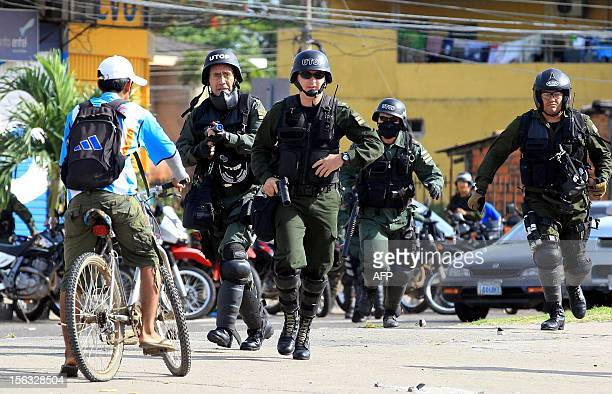 Riot police officers clash with demonstrators as Bolivia's transport and trade unions hold a oneday strike to protest a proposed law that would allow...
