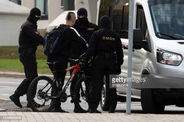 Riot police officers detain a man during a rally demanding to free jailed activists of the opposition in Minsk on October 4 2020 Belarusian police on...