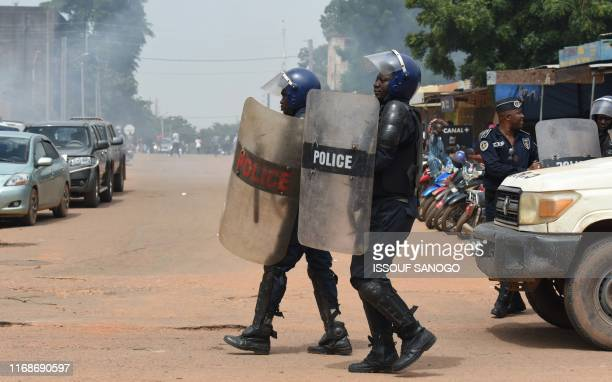 Riot police officers disperse a march called by the UAS union asking for better security measures against terrorism, on September 16, 2019 in...