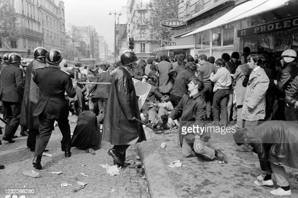 Riot police officers disperse demonstrators on Saint Jacques street in Paris during the demonstration organised by the student union UNEF on May 6,...