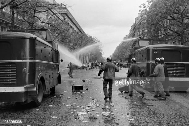 Riot police officers disperse demonstrators with a water cannon on Saint-Germain boulevard in Paris during the demonstration organised by the student...