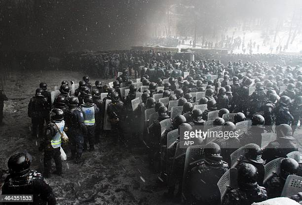 Riot police officers gather as they clash with protestors in the center of Kiev on January 22 2014 Ukrainian police today stormed protesters'...