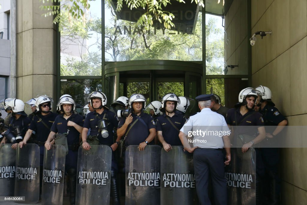 Riot police officers guard the entrance of the Environment, Energy and Climate Change Ministry, in Athens,on September 13, 2017. Miners from Eldorado gold mine in northern Greece demonstrate at the Ministry, against the suspension of Eldorado's investment in Greece, the Canadian gold mining company announced on Monday that it will suspend its operations in Greece, following a three months of unsuccessful negotiations and talks with the energy and environment ministry.