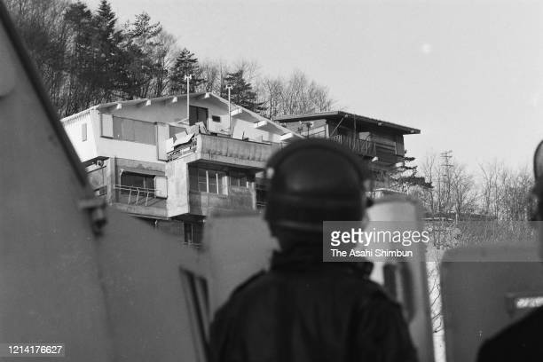 Riot police officers look up the Asama Sanso lodge where the United Red Army members take a hostage on February 21 1972 in Karuizawa Nagano Japan