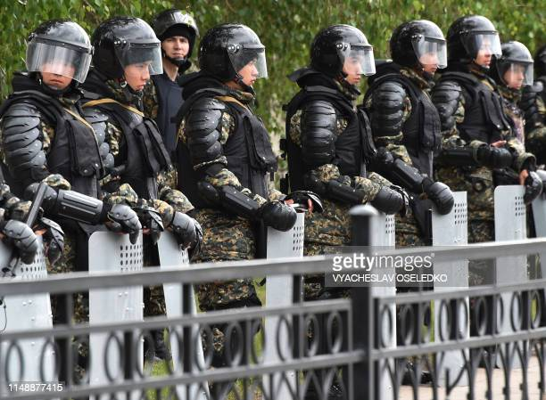 Riot police officers patrol the street on June 10 2019 in NurSultan a day after Kazakhstan's presidential elections Kazakhstan elected the handpicked...