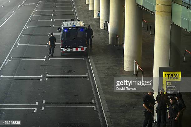 Riot police officers patrols in a empty taxi stop at the Barcelona Airport during a 24 hours cabs strike against Uber Taxi app on July 1 2014 in...