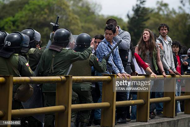 Riot police officers try to disperse a group of students demonstrating outside the National University in Bogota on May 15 2012 hours after a free...