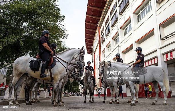 Riot police on horseback gather before the UEFA Champions League Group D match between Sevilla FC and VfL Borussia Monchengladbach at Estadio Ramon...