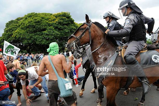 Riot police on horses charge on Brazilian students during a protest against Federal District governor Jose Roberto Arruda as part of the...