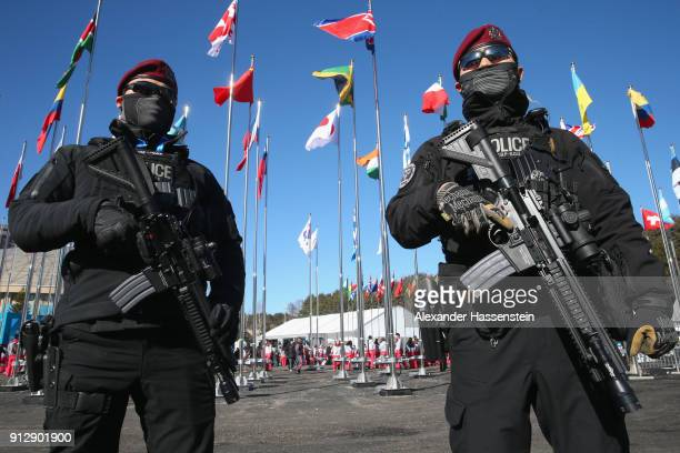 Riot Police patrol during the PyeongChang 2018 Olympic Village opening ceremony at the PyeongChang 2018 Olympic Village Plaza on February 1 2018 in...