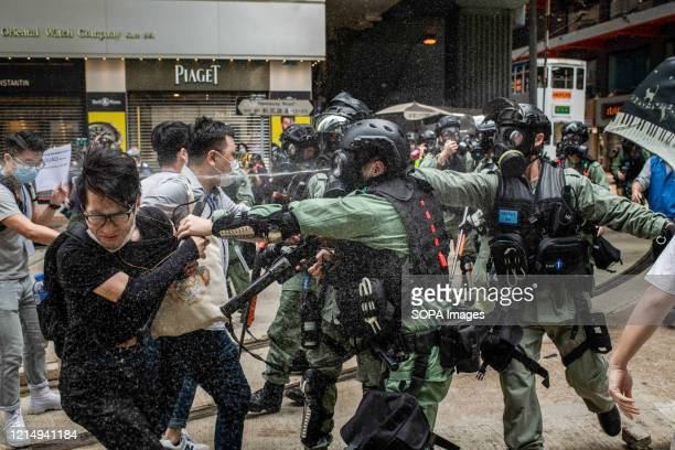 Riot police pepper spray while clashing with a group of mediators during demonstrations against the draft bill Hong Kong police fired teargas and...