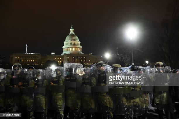 Riot police prepare to move demonstrators away from the US Capitol in Washington DC on January 6, 2021. - Donald Trump's supporters stormed a session...