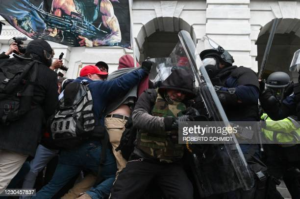 Riot police push back a crowd of supporters of US President Donald Trump after they stormed the Capitol building on January 6, 2021 in Washington,...