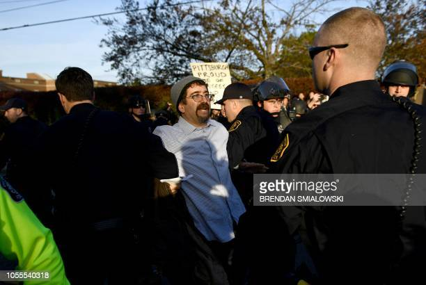 Riot police remove a protester near the Tree of Life Congregation on October 30 2018 in Pittsburgh Pennsylvania Scores of protesters took to the...