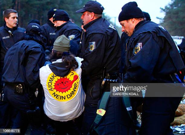 Riot police remove anti-nuclear protesters who blocked the track of the Castor transport of nuclear waste in Gorleben, northern Germany, on early...