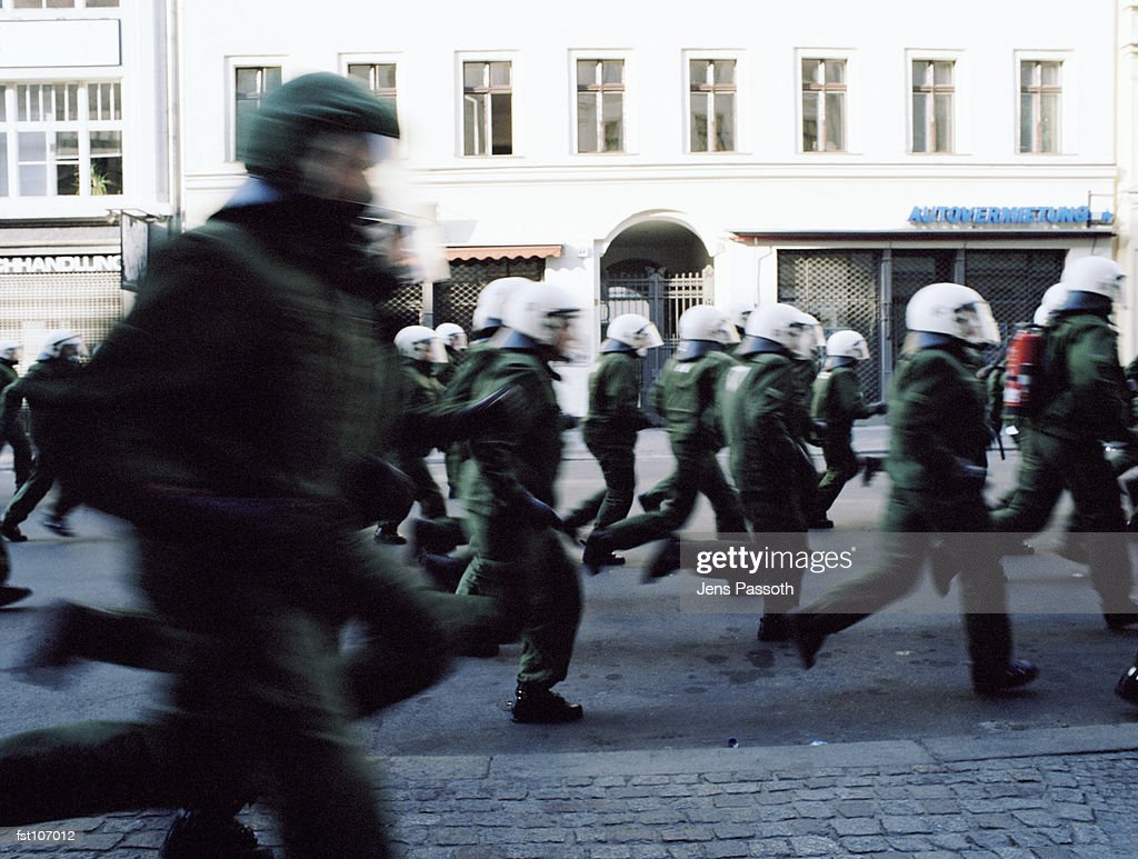 Riot police running in street : Stock Photo