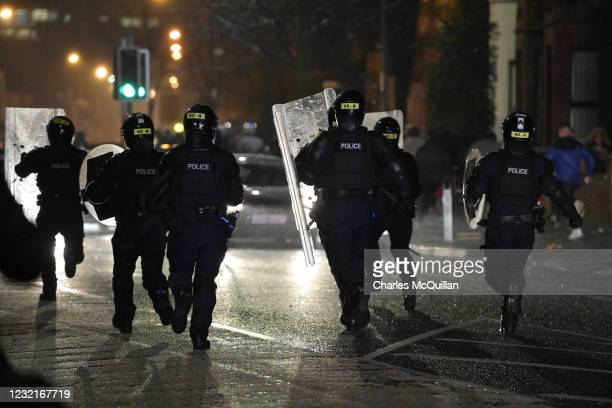 Riot police rush during clashes between youths continued at the Springfield Road/Lanark Way interface on April 7, 2021 in Belfast, Northern Ireland....