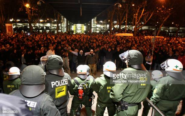 Riot police safe the stadium whilst supporters of Stuttgart vent their displeasure after the Bundesliga match between VfB Stuttgart and VfL Bochum at...