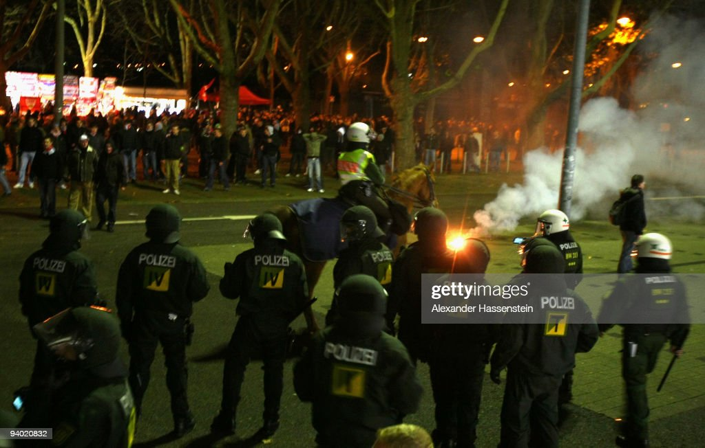 Riot police safe the stadium whilst supporters of Stuttgart vent their displeasure after the Bundesliga match between VfB Stuttgart and VfL Bochum at Mercedes-Benz Arena on December 5, 2009 in Stuttgart, Germany.