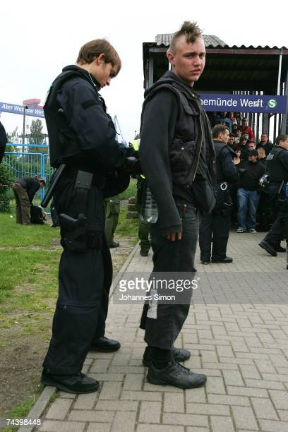 Riot police search anti- G8 activists as they cross a bridge during a demonstration on June 5 in Rostock Warnemuende, Germany. German authorities...