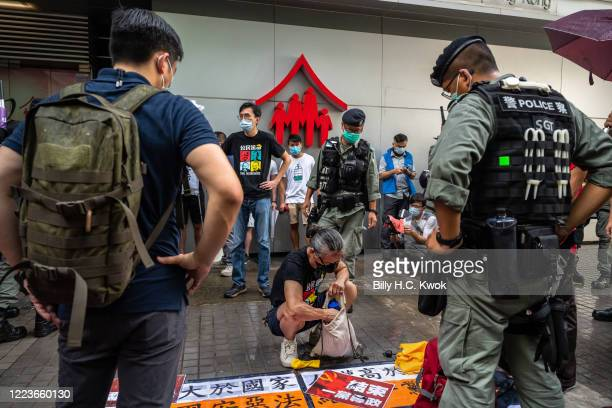 Riot police search Prodemocracy prostesters as they rally against a new national security law on the 23rd anniversary of the city's handover from...