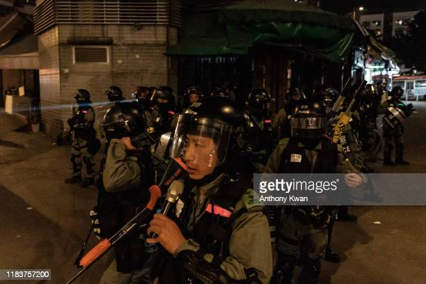 Riot police secure an area after protesters gathered on a street on November 21 2019 in Hong Kong China Antigovernment protesters armed with bricks...