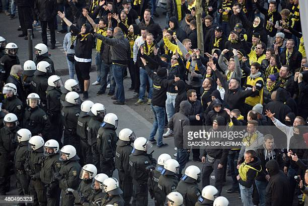 Riot police separate opposing fan blocks prior to the German first division Bundesliga football match Borussia Dortmund vs FC Schalke 04 in Dortmund...