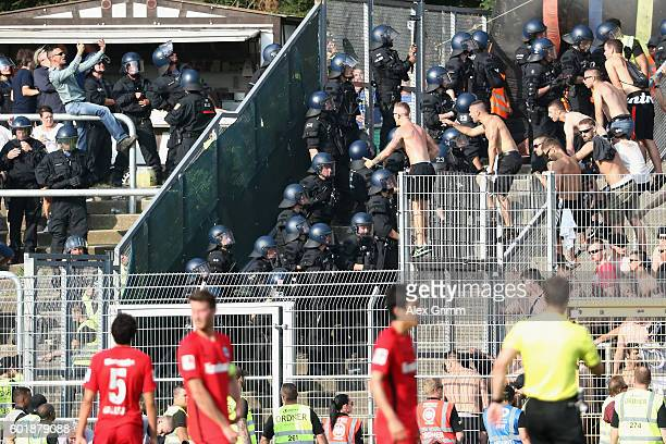 Riot police seperates fans of Frankfurt and darmstadt during the Bundesliga match between SV Darmstadt 98 and Eintracht Frankfurt at...