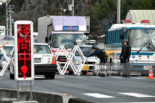 Riot police set up a security check point on a road leading to Nagato city ahead of the visit of Russian President Vladimir Putin on December 15 2016...