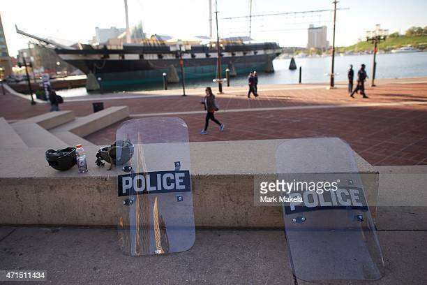 Riot police shields lay on a concrete bench in the inner harbor under close monitoring by the National Guard following days of citywide riots and...