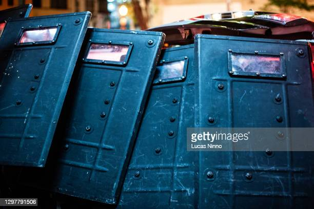 riot police shields - riot shield stock pictures, royalty-free photos & images