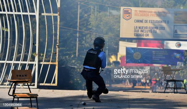 Riot police shoot tear gas during clashes with students of the National Autonomous University of Honduras demanding justice for the murder of...