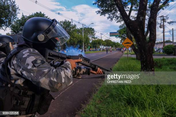 Riot police shoot tear gas to disperse opponents of former Brazilian President Luiz Inacio Lula da Silva in Foz do Iguau Parana State Brazil on March...