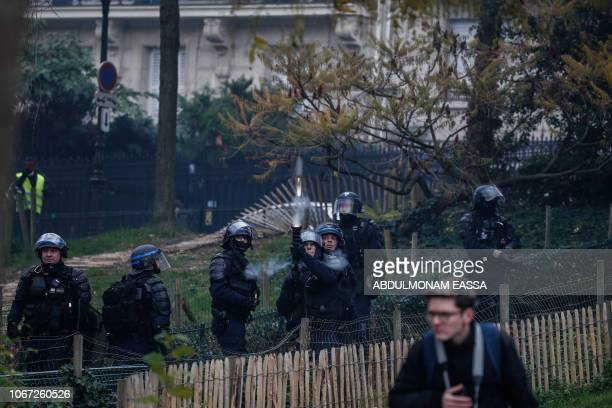 Riot police shot smoke grenades at protesters during a demonstration by Yellow vests against rising oil prices and living costs on December 1 2018 in...