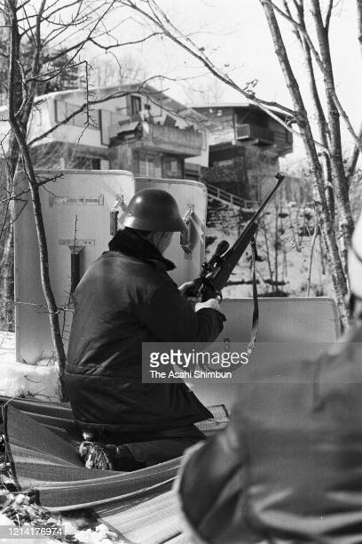 A riot police sniper takes prepares as the United Red Army members take a hostage at the Asama Sanso lodge on February 24 1972 in Karuizawa Nagano...
