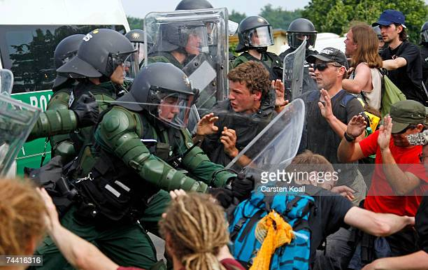 Riot police spray gas to stop activists of the anti G8 forum Block G8 demonstrate on a street on June 06 2007 in Nienhagen close to Heiligendamm...