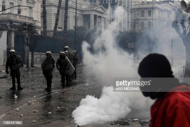 Riot police stand amid tear gas during a demonstration against the agreement with Skopje to rename neighbouring country Macedonia as the Republic of...