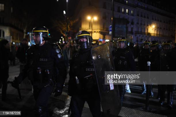 CRS riot police stand as protestors gather in front of the Bouffes du Nord theatre in Paris on January 17 2020 as French President attends a play...