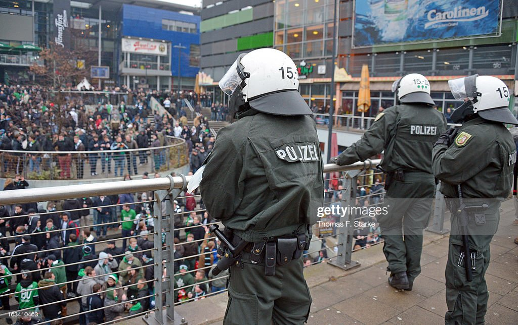 Riot police stand at the train station in front of Muenster supporters prior to the Third League match between Arminia Bielefeld and Preussen Muenster at Schueco Arena on March 9, 2013 in Bielefeld, Germany.
