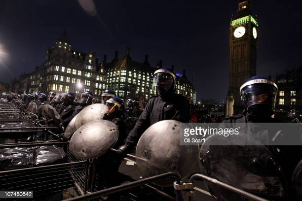 Riot police stand guard against student protesters in Parliament Square on December 9 2010 in London England Parliament is voting today on whether to...