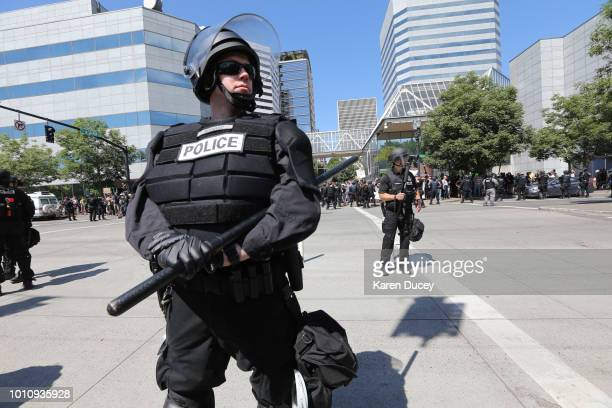 Riot police stand guard as right-wing demonstrators hold a rally supporting gun rights and free speech on August 4, 2018 in Portland, Oregon. The...