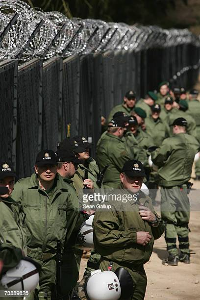 Riot police stand guard at a section of a 14km long security fence around the German resort town of Heiligendamm which will host the upcoming G8...