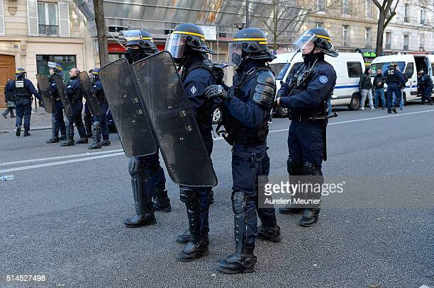 Riot police stand guard at the Place de la Nation securing the area during the demonstration against labour reforms on March 9 2016 in Paris France...