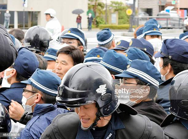 Riot police stand guard during the Takeshima Sovereignty Ceremony on February 22 2015 in Matsue Japan South Korea and Japan have been claiming the...