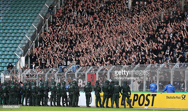 Riot police stand guard infront of supporters of Frankfurt during the DFB Cup match between 1 FC Magdeburg and Eintracht Frankfurt at MDCCArena on...