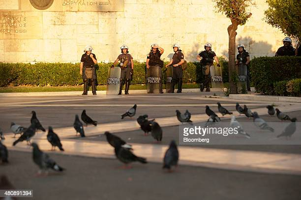 Riot police stand guard near the Tomb of the Unknown Solider outside the Greek parliament during a demonstration by antibailout protestors in central...