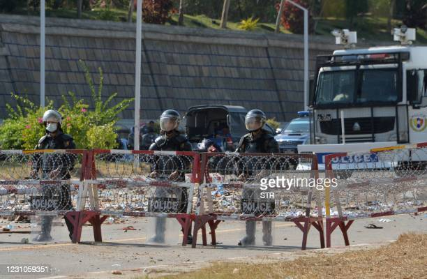 Riot police stand guard on a road during a demonstration against the military coup in Naypyidaw on February 9, 2021.