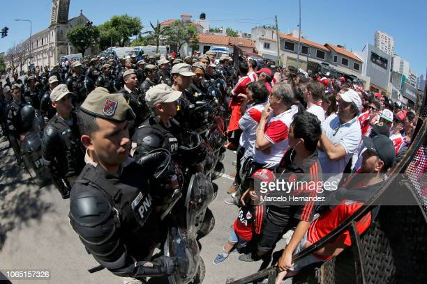 Riot police stand guard outside of Monumental Stadium of River Plate before the second leg of the final of Copa CONMEBOL Libertadores 2018 between...