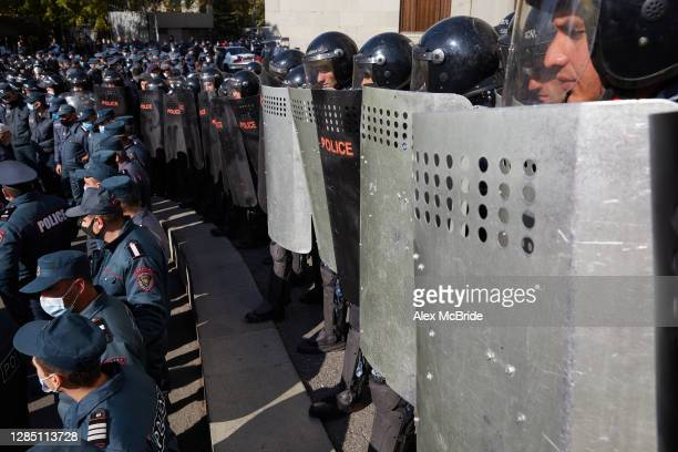 Riot police stand in formation as protesters demand the removal of Armenian Prime Minister Nikol Pashinyan from office in Freedom Square on November...